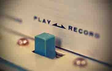 Play and record control on reel tape recorder. Vintage effect
